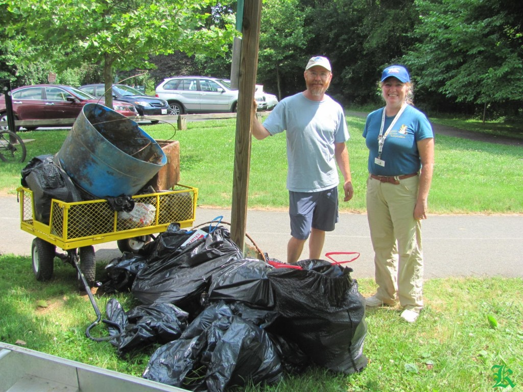 volunteers standing next to all the trash they collected